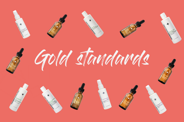 "Vivant Skin Care products on a pink background, surrounding the phrase ""gold standards"""