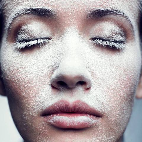 Woman with snow frost on her face