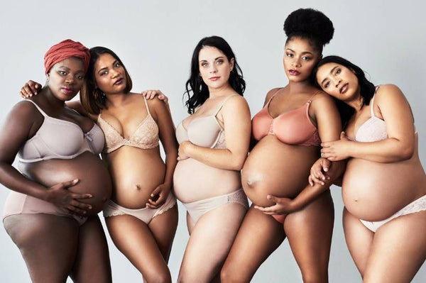 A group of pregnant women monochromatic nude clothing