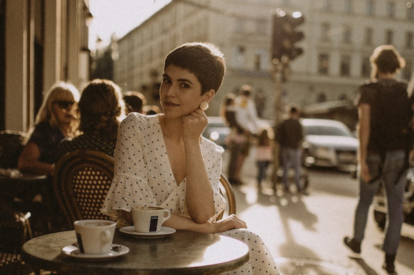 Short haired woman sitting at a cafe