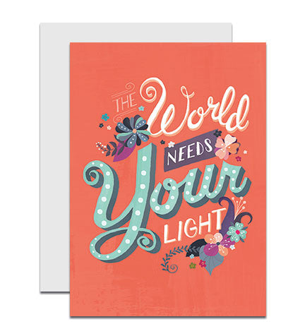 Greeting card with the hand lettered words 'The World Needs Your Light'