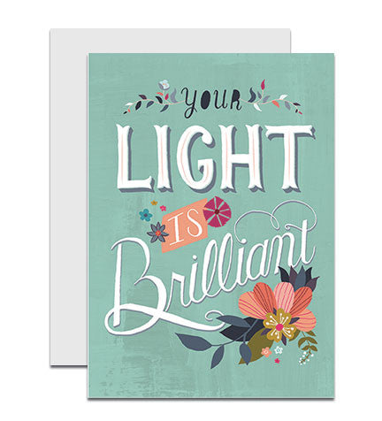 Greeting card with the hand lettered words 'The Worlds Needs Your Light'