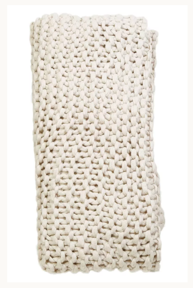 a knit throw in taupe