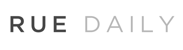 Rue Daily in grey and black font