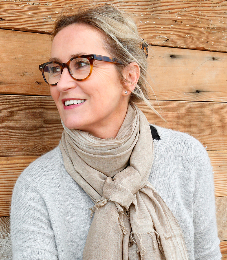 hilde in glasses and a taupe scarf