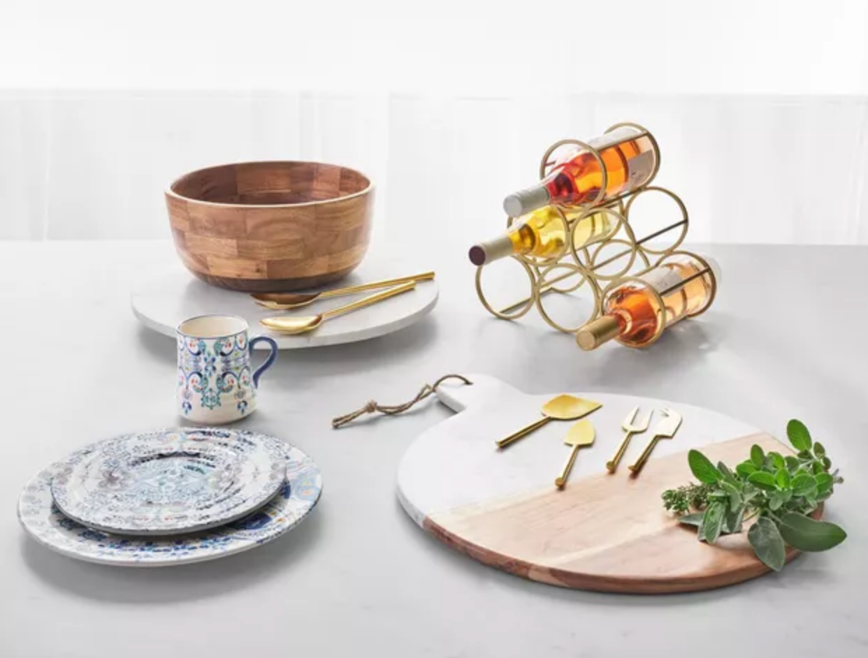 dinnerware on a table with a wine rack