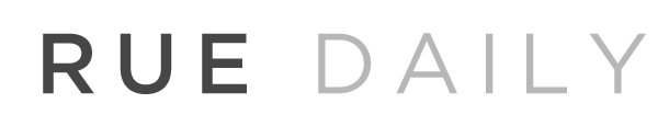 black and grey font that reads Rue Daily