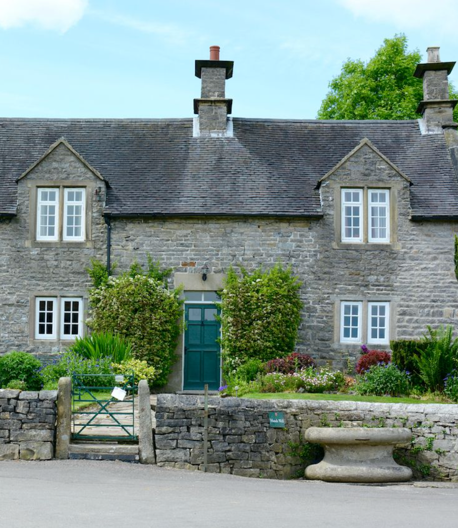 a very old quaint home made from stone