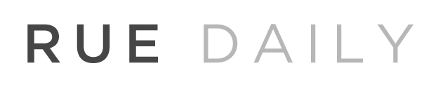 black and grey font reads Rue Daily