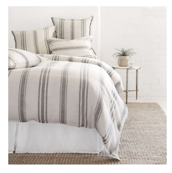 linen bedding on bed, striped grey blue on flax background,  duvet and four pillows