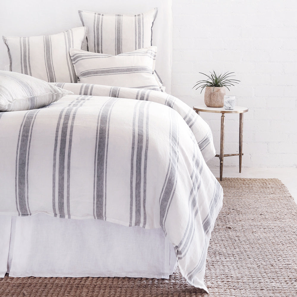 Striped linen bedding on a bed