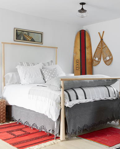 An eclectic bedroom with a Gucci surfboard