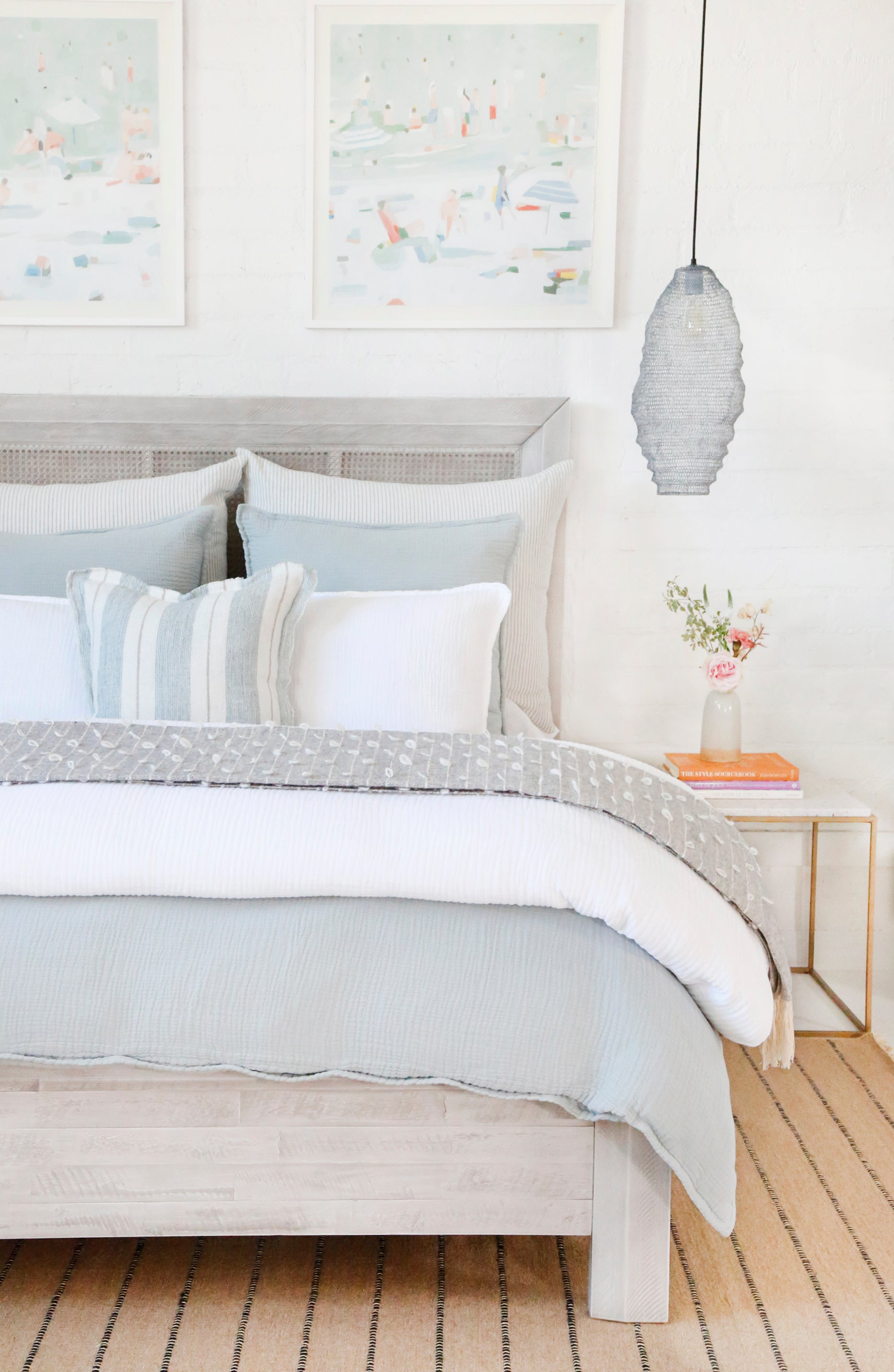 blue and white bedding on bed, lots of pillows