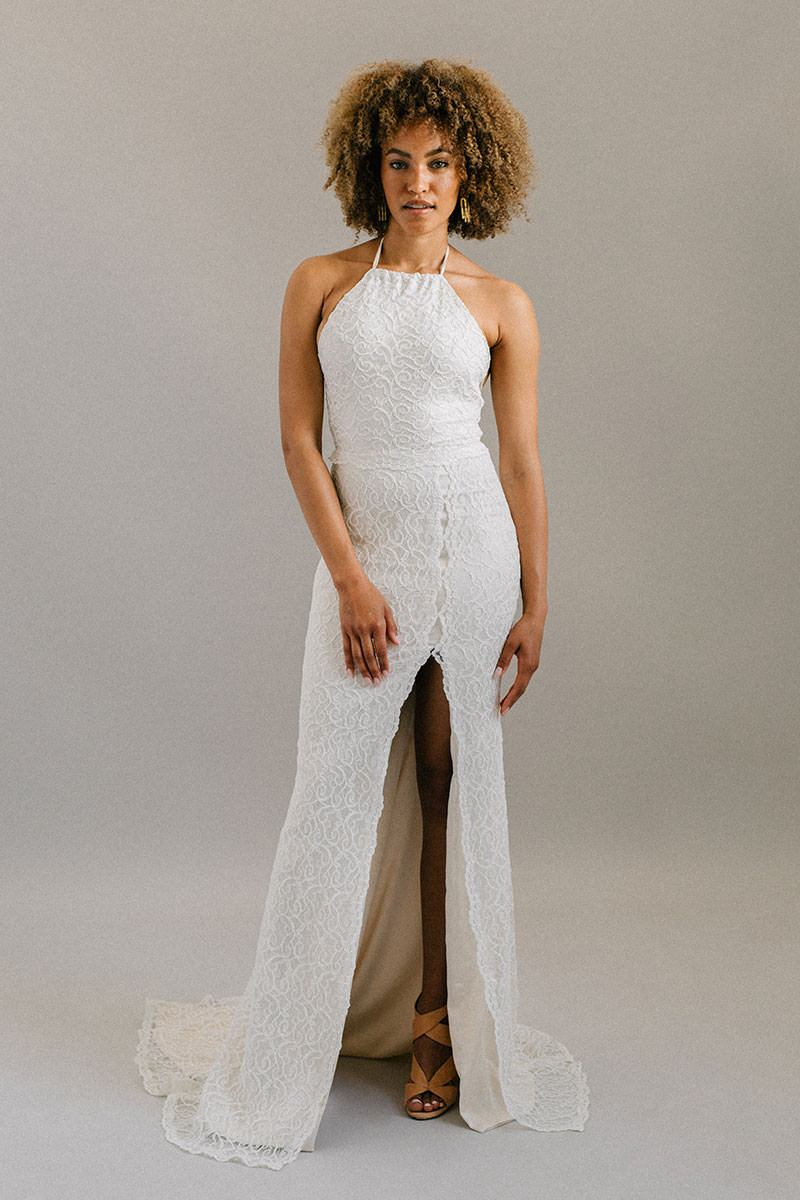 Halter neck, open back lace wedding dress with a leg slit and satin tie back