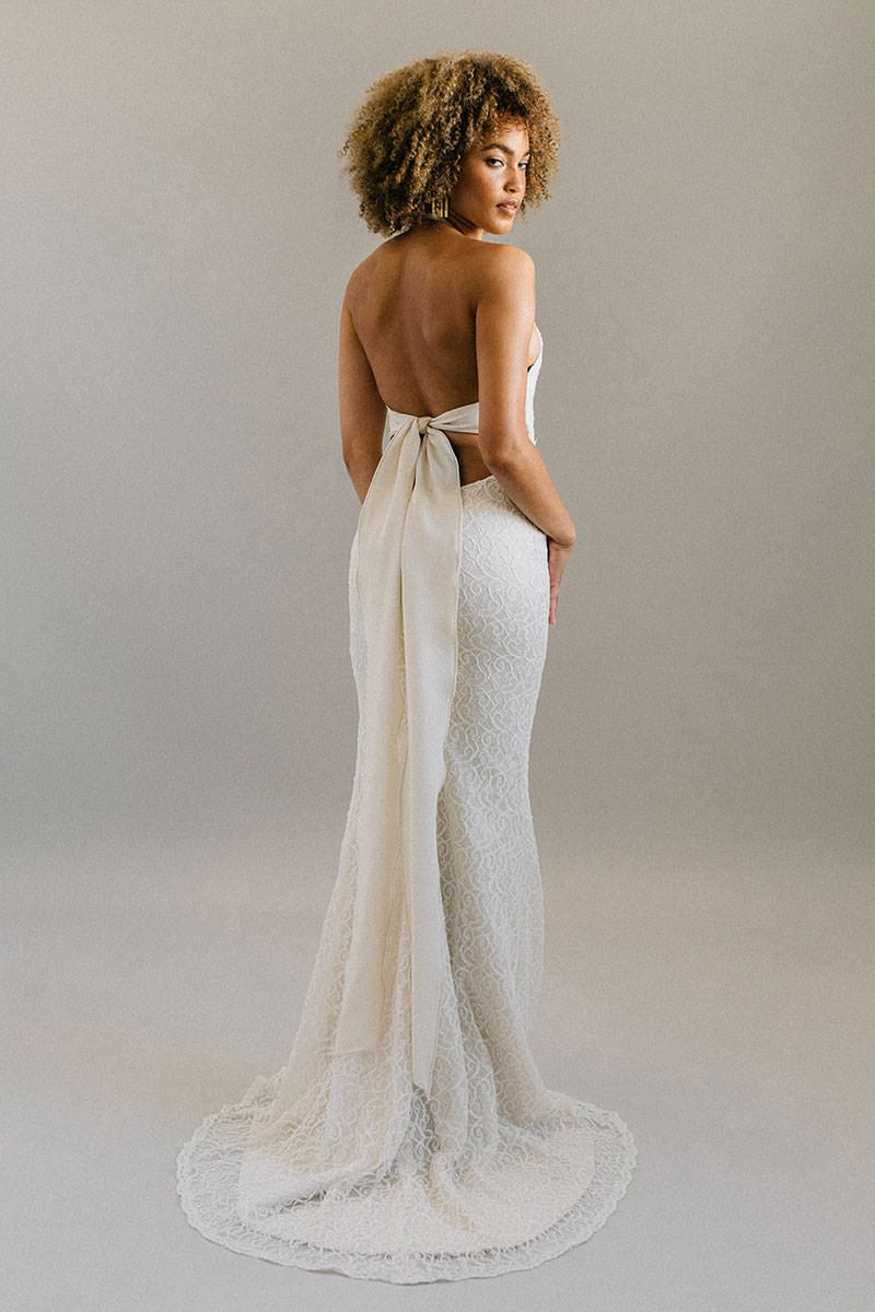 b9974e203d Boho beach wedding dress with a halter neck, fitted skirt and cream lace