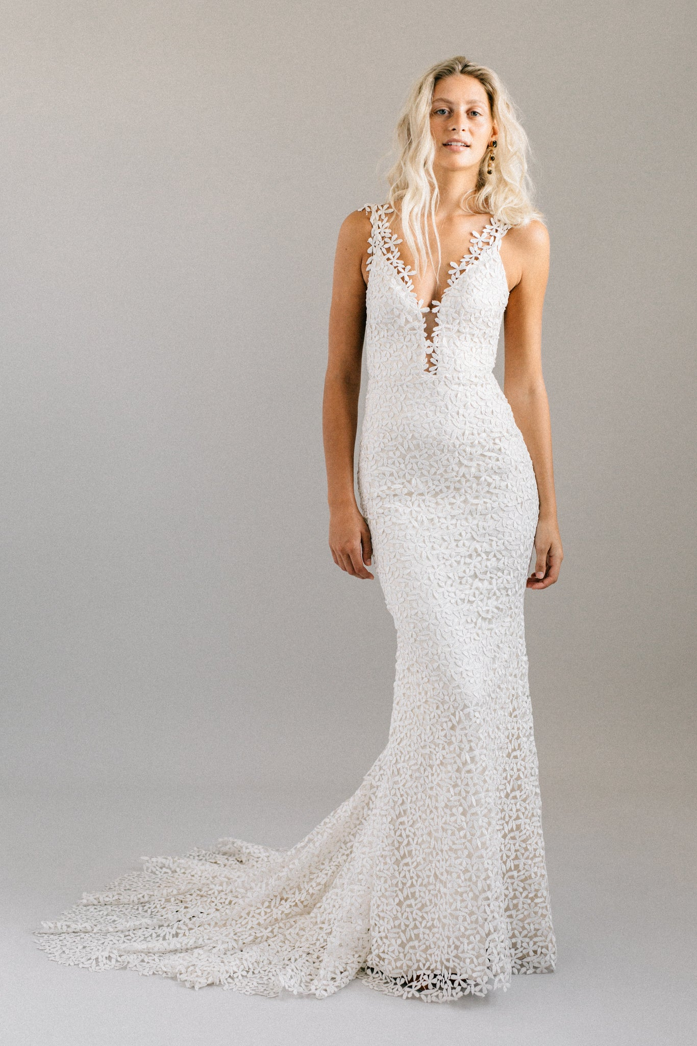 Flower print mermaid wedding dress with an open back, extra long train and a plunging neckline