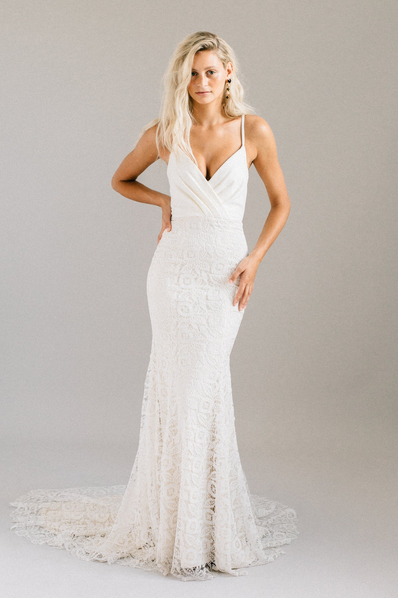 Boho wedding dress with a velvet top and a fitted mermaid lace skirt