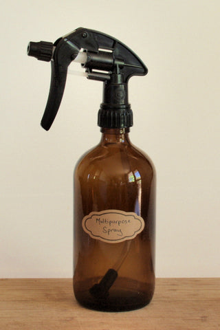 Amber glass spray bottle, black trigger spray, brown label with text