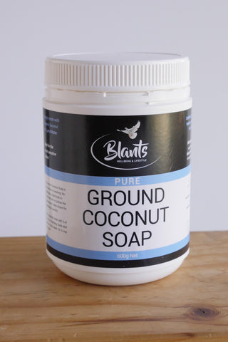 Ground coconut soap in white tub