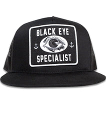 The BLACK EYE SPECIALISTS Classic Trucker Cap