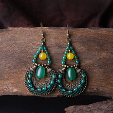 Green and yellow stone vintage earrings