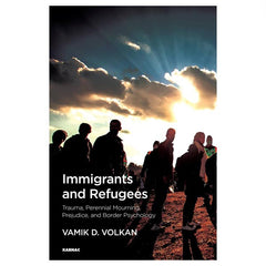 Book cover for Immigrants and Refugees by Vamik Volkan of silhouettes of people walking into the sunset.