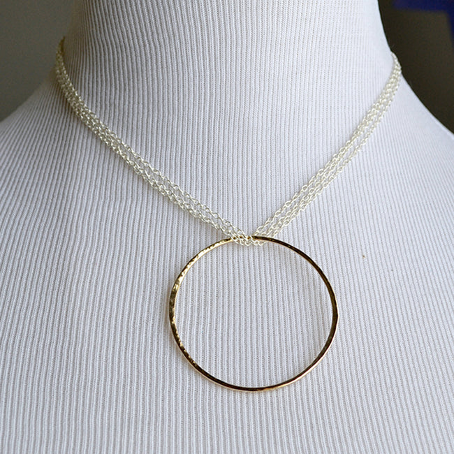 eternity necklace. 14 karat gold and sterling silver mixed metal necklace.