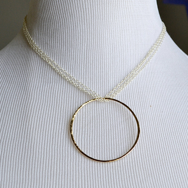 eternity necklace. 14 karat gold and sterling silver mixed metal necklace.14 karat gold pendant on sterling silver chain
