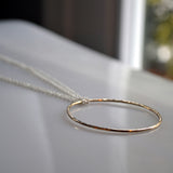 gold eternity circle pendant on silver chain