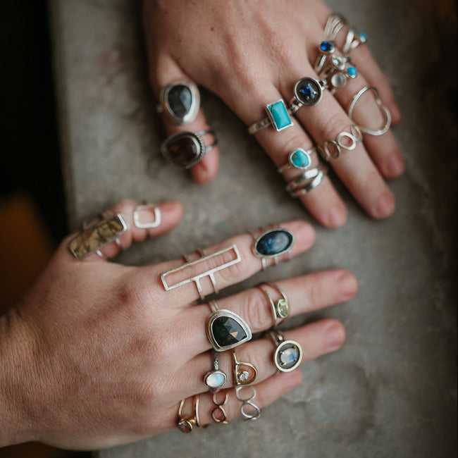bohemian style rings in silver and gold with gemstones
