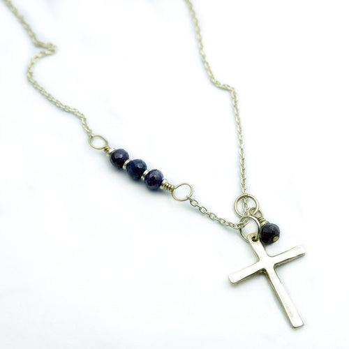 silver cross necklace accented with genuine sapphire beads.
