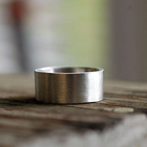 wide smooth modern wedding band completely handcrafted