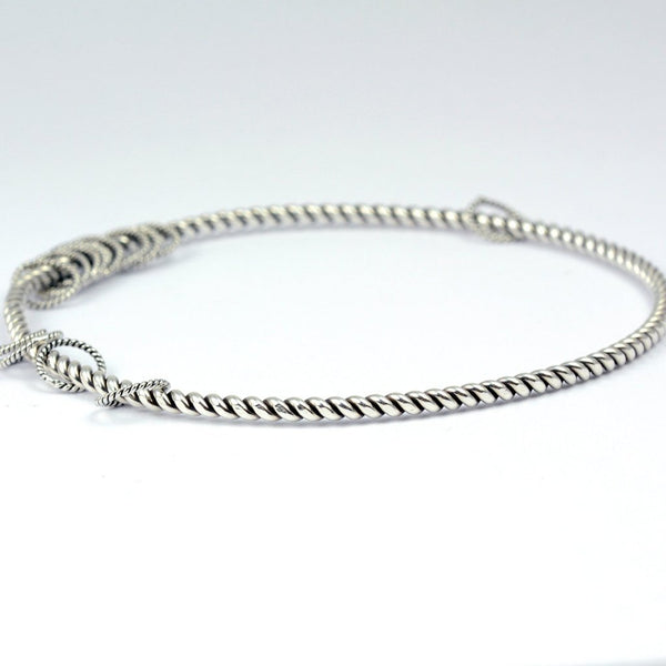 stacking bangle with a twist and dangle silver ring accents