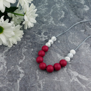 Ruby Riot: Bubbles Teething Necklace - Pebbles and Lace
