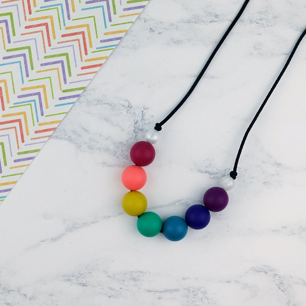 Stormy Rainbow: Radiant Rainbows Silicone Teething Necklace