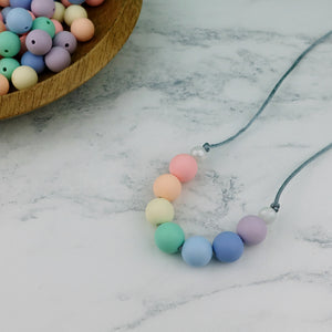 Watercolour Pearls: Radiant Rainbows Teething Necklace - Pebbles and Lace