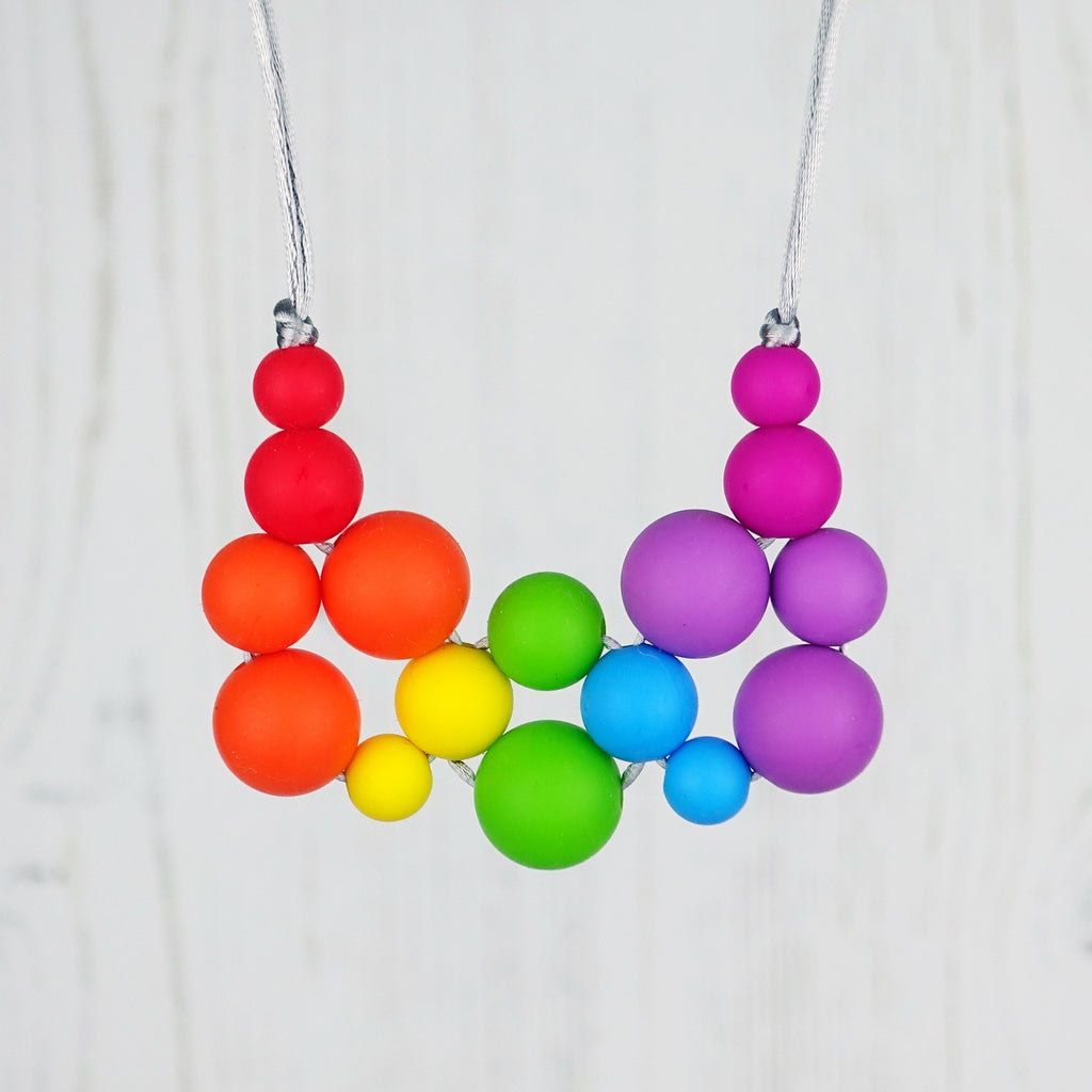Rainbow Bright: Woven Joy Wonders Teething Necklace