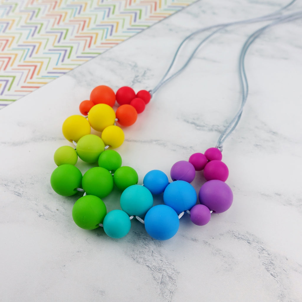 Rainbow Dazzle: Woven Glory Teething Necklace