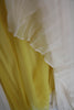 Detail yellow lining of the silk chiffon dress