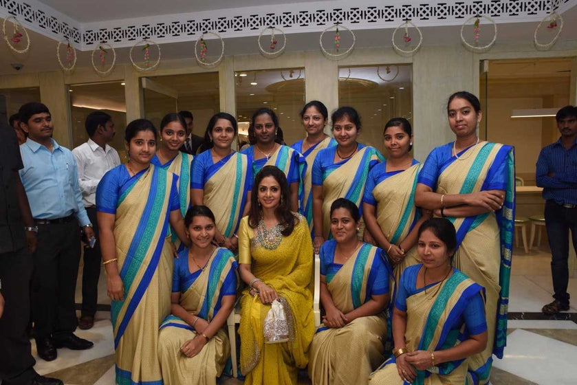 Bollywood Star Sridevi Boney Kapoor with the staff of a premium jewellery showroom donned Uniform Sarees by www.uniformsarees.in