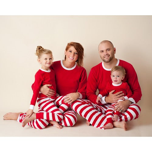 Family with Red and White Striped Christmas Pajamas