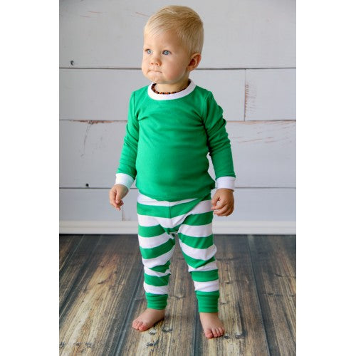 little boy wearing green and white striped pajamas
