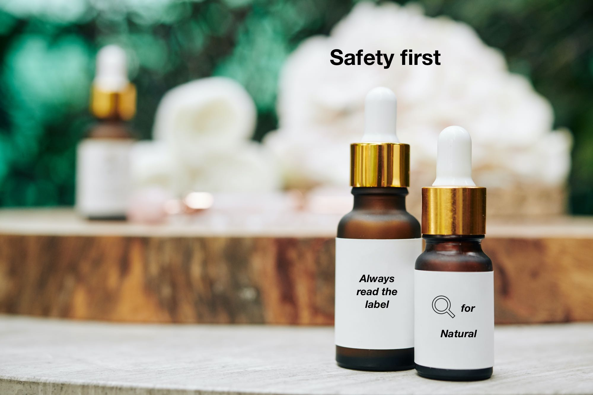 Two bottles of essential oils with edited labels saying: Always read the label and: safety first.