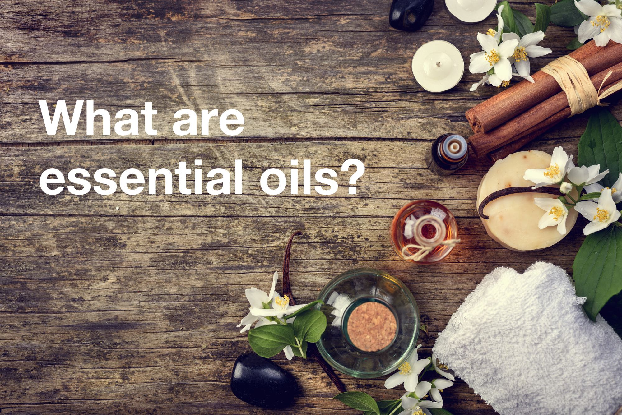 A display of essential oil ingredients with an overlay saying: what are essential oils
