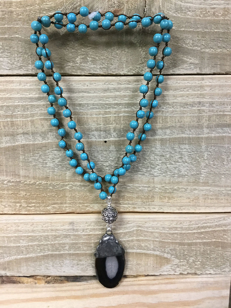 Turquoise Necklace with a Black Rock Drop