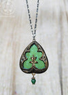 Eunomia ~ Floriated Ornament ~ Iridescent Stained Glass Amulet