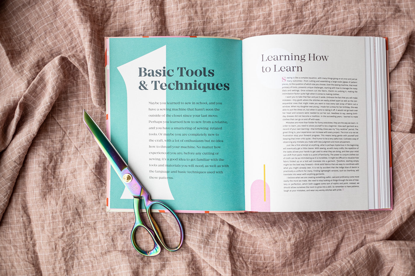 The book open to the first chapter, Basic Tools and Techniques, and a pair of scissors
