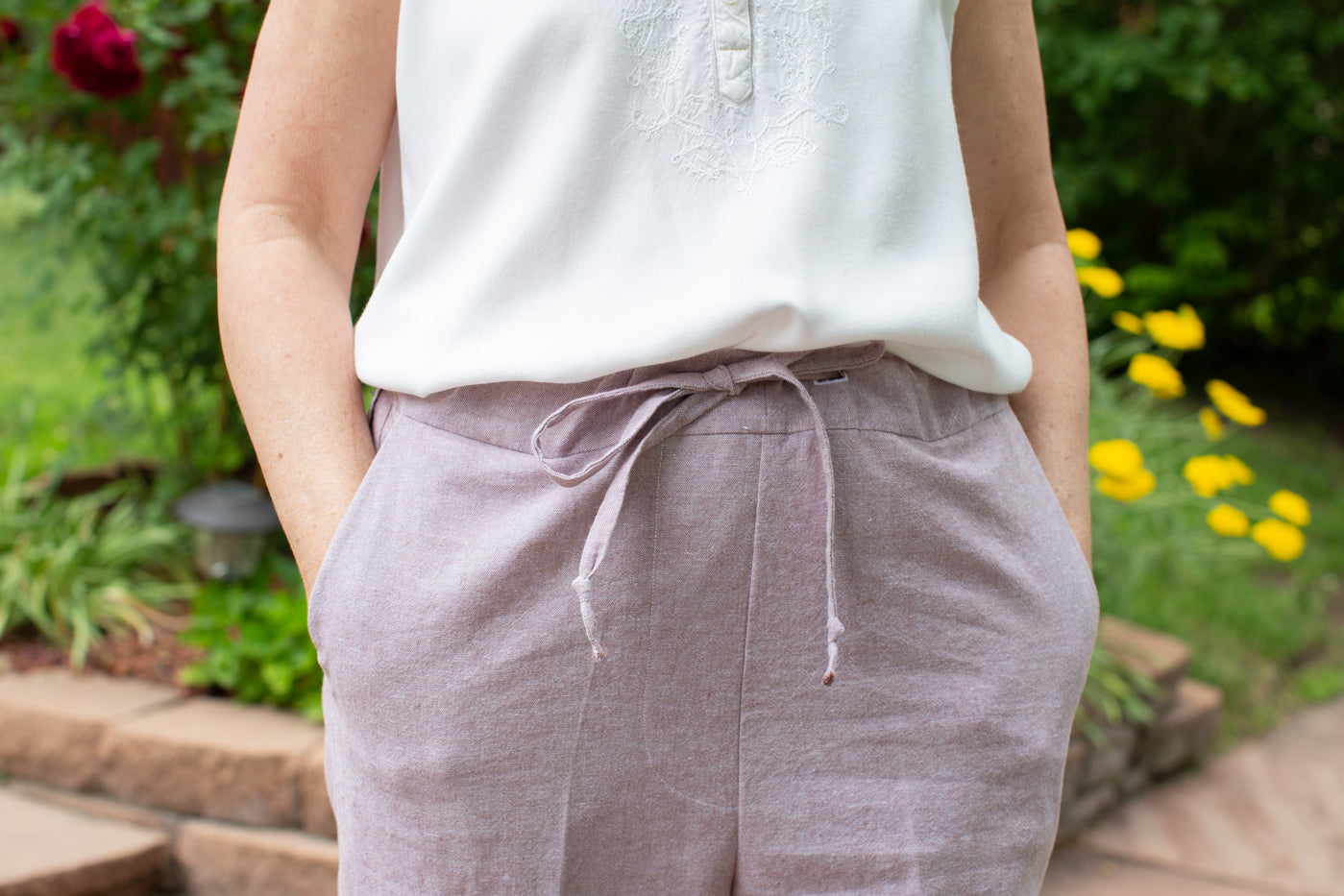 Up close detail photograph of women in mocha essex fabric to show the pocket of the pants.