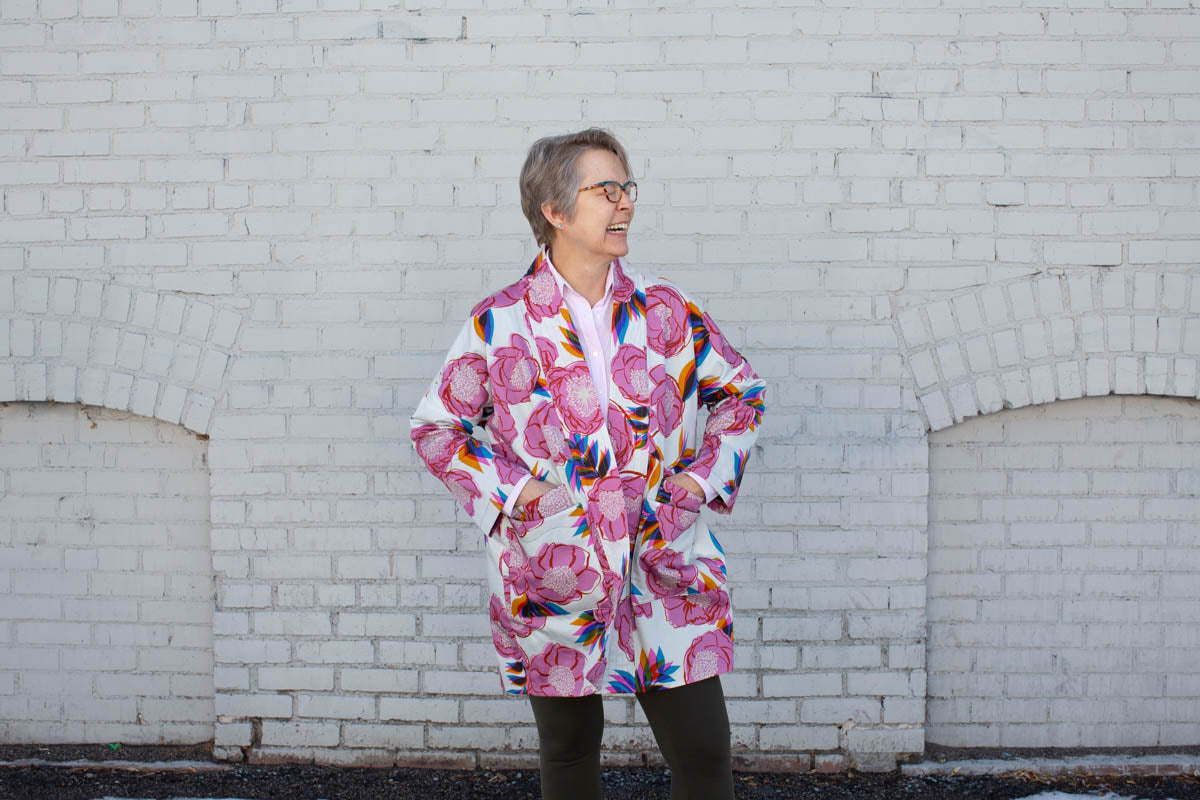 Woman in floral jacket