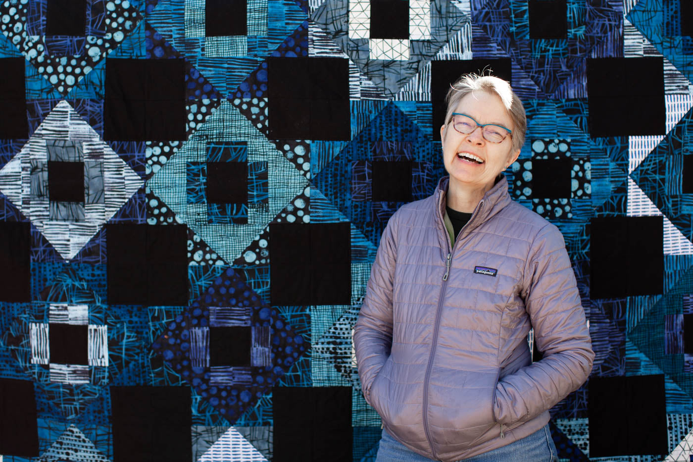 Woman and patchwork quilt